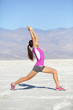 Fitness yoga woman stretching warrior one pose