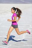 Running woman - runner sprinting on trail run