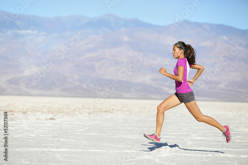 Runner woman running and sprinting on trail run