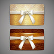 set of golden gift cards with white bows