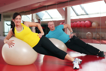 Young caucasian couple working out