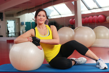 Young caucasian woman with fitball