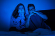 Caucasian couple watching scary movie