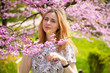 Beautiful woman in spring blossom