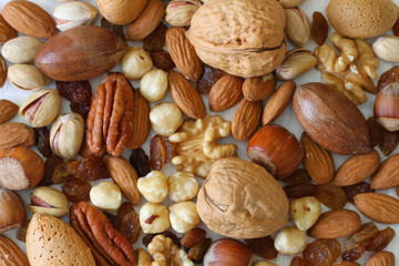 Selecion of nuts, almonds and sultanas, close up