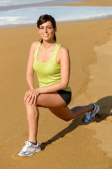 Woman stretching and exercising on beach