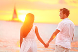 Couple in love happy at romantic beach sunset - Fine Art prints
