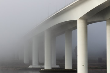Bridge in the early morning mist
