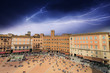 Wonderful aerial view of Piazza del Campo, Siena during a storm