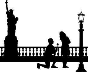 A young man with rose woo the girl in New York silhouette