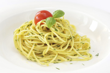 Italian spaghetti pasta with tomato and basil in white dish