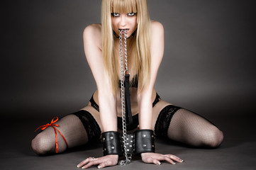 beautiful woman in handcuffs holding a leash in his mouth