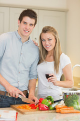 Smiling couple preparing dinner