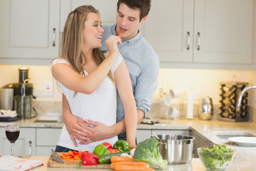 Woman feeding man jokingly