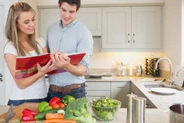 Couple reading cookbook