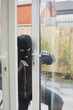 Burglar opening the terrace door