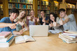 Group of students giving thumbs up