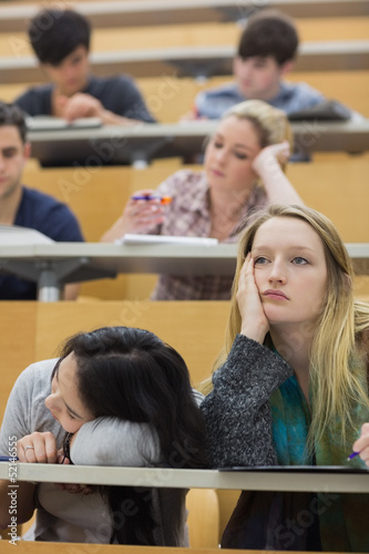 Bored students sitting in a lecture hall