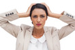 Stressed businesswoman holding her head between hands