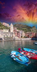 Colorful boats in the quaint port of Vernazza, Cinque Terre - It