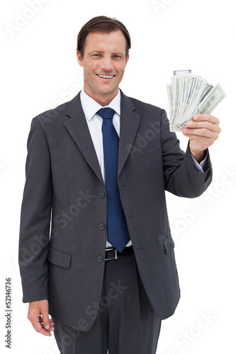 Smiling businessman holding dollar bills