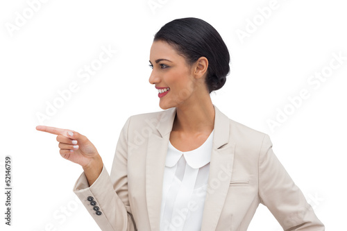 Profile view of a smiling businesswoman pointing