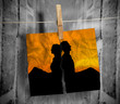 Torn photo of couple hung with a peg on a line