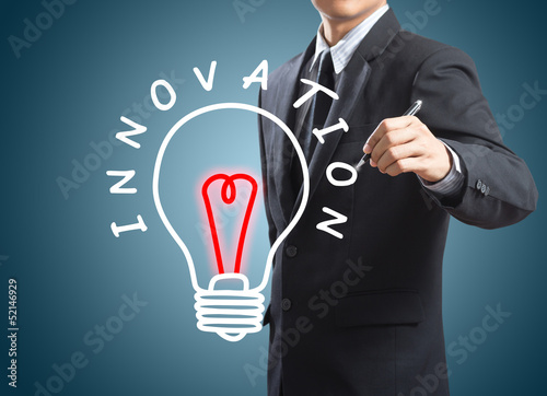 business man writing innovation concept