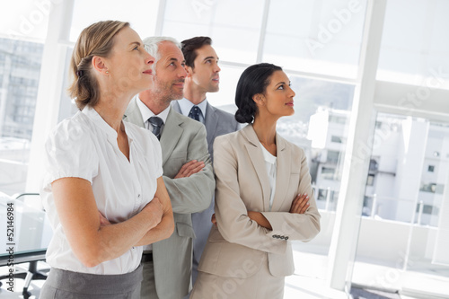 Confident business people looking at the same way