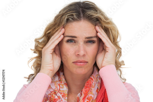Blonde woman suffering with headache