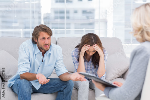Young couple sit on the couch of the therapist
