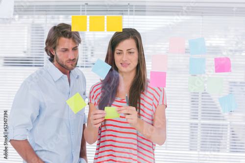 Colleagues reading sticky note
