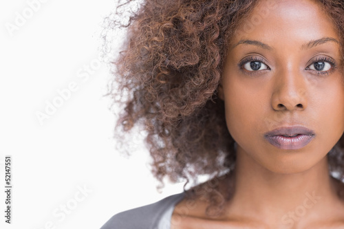 Unsmiling woman looking at camera