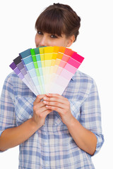 Pretty woman with fringe showing colour charts