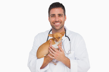 Happy vet holding chihuahua