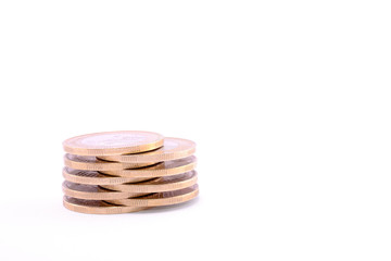 Mini coins tower isolated on a white