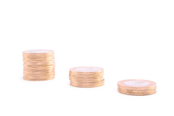 Coins towers isolated on a white