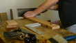Luthier, craftsman or carpenter, cuts wood.