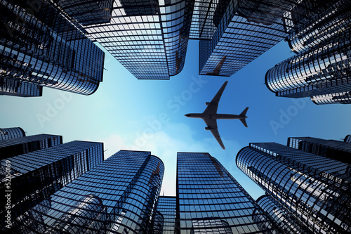 Fototapety, obrazy : Business towers with a airplane silhouette