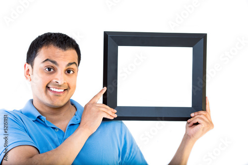 Young happy guy holding an empty frame