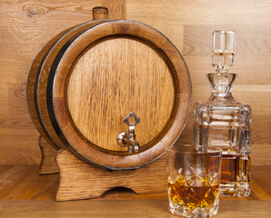 glass of whiskey, carafe and barrel