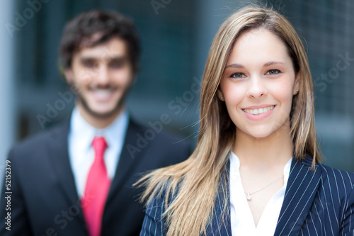 Two business people outdoor smiling