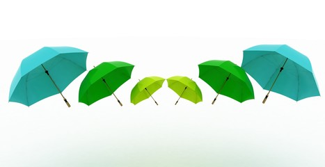 3d illustration multicoloured umbrellas on a white