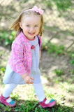 Cute little girl walking and smiling to you - casual outdoor por