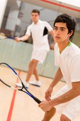 Males playing squash