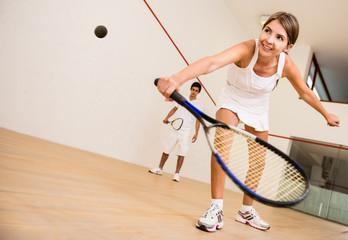 Woman playing squash
