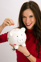 Save a Quarter Smiling Woman Drops Quarter into Piggy Bank