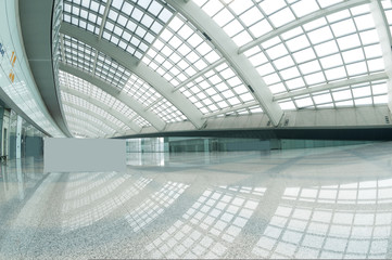 interior of the modern mall of beijin airport subway station