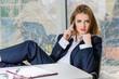 Businesswoman in man's suit & shirt