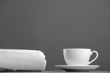 White mug and newspaper